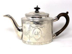 A George III silver teapot, William Plummer, London 1781, bearing initials 'G J C', height 14cm.