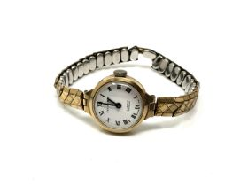 A lady's 9ct gold cased Excalibur wristwatch on gilt expanding strap.