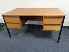 A 20th century teak twin pedestal desk on metal legs