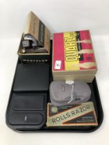 A tray containing a vintage movie camera, a viewmaster, shavers etc.