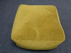 A contemporary yellow footstool