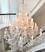 A large and impressive forty-branch crystal chandelier, modern, consisting of five tiers,