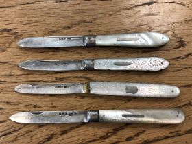 Four antique silver and mother of pearl handled fruit knives.