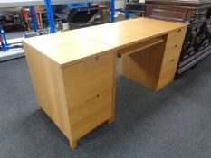A contemporary three drawer single pedestal desk with slide together with two drawer filing chest