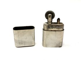 A silver 'The Howitt Lighter' with engine turned decoration, Sheffield 1946.