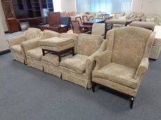 A late 20th century continental four piece lounge suite upholstered in a floral fabric comprising