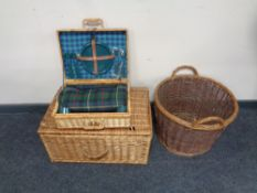 A wicker twin handled log basket together with a wicker cased picnic set and a further wicker