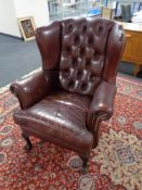 A Burgundy button leather Chesterfield wingback chair