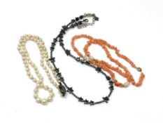 Three necklaces, pearl, coral and white metal.