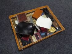 A counter top display cabinet containing a large quantity of assorted jewellery boxes,