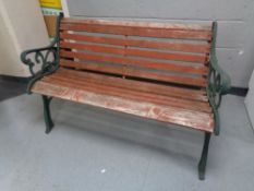 A cast iron wooden slatted garden bench