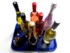 A tray containing eight assorted bottles of alcohol to include Rose wine, Cava Brut,