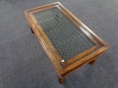 A William Sheppee Indian Collection Jali glass topped coffee table
