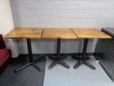 Three pine topped cast iron based cafe tables