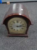 An Edwardian bracket clock with silver dial (electric)