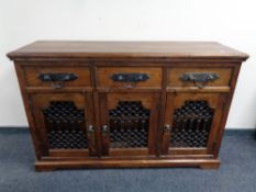 A William Sheppee Indian Collection Tansen triple door sideboard