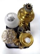 A tray containing two brass oil lamps with chimneys, one with shade, converted,