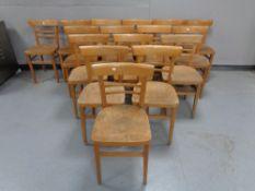 Sixteen wooden school chairs