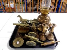 A tray containing antique and later brass ware to include converted brass oil lamp, candlesticks,