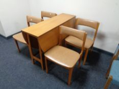 A 20th century teak drop leaf table and four chairs