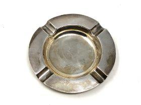 A silver ashtray,