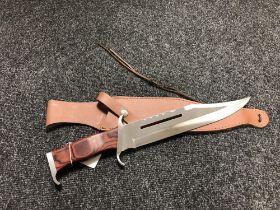 A 'Rambo III' hunting knife in sheath