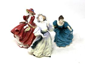 Thre Royal Doulton figurines Top o' the Hill HN1834, Rhapsody HN2267 and Grand Manner HN2723.