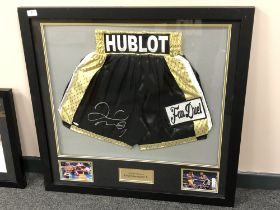 A sporting memorabilia montage : A signed pair of boxing shorts, Floyd Mayweather Jr.