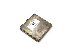 A silver cigarette case with engine turned decoration,