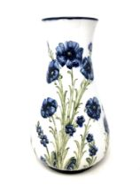 A William Moorcroft Macintyre Florian Ware Poppy Pattern vase, signed to base, height 31cm.