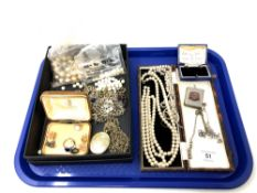 A tray of costume jewellery, pearls, silver plated vesta case,