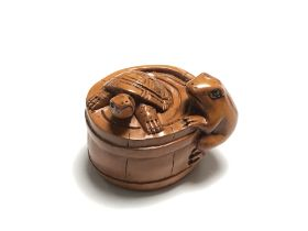 A carved Chinese hardwood netsuke - Turtle and frog by a barrel