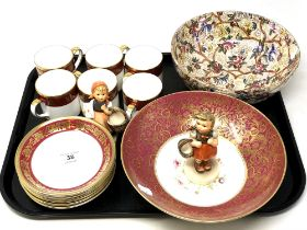 A tray of Crown Staffordshire part bone china coffee set, two West German figurines,