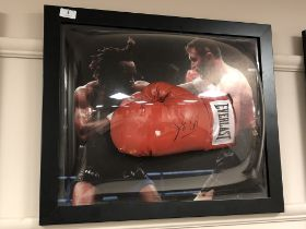 A sporting memorabilia montage : A signed red Everlast boxing glove, Steve Collins,
