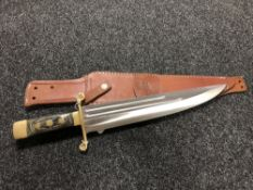 A large hunting knife in leather sheath