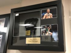 A sporting memorabilia montage : A signed UFC boxing mitt Conor McGregor,