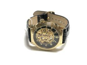 A Gentleman's Stuhrling skeleton style wrist watch