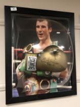 A sporting memorabilia montage : A signed gold Everlast boxing glove, Joe Calzaghe,