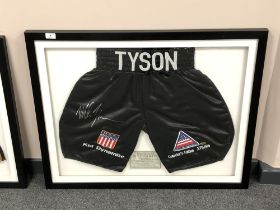 A sporting memorabilia montage : A signed pair of boxing shorts, Mike Tyson 'Kid Dynamite',