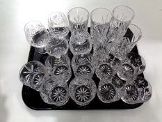 A tray containing lead crystal glassware to include high ball glasses, whiskey tumblers,