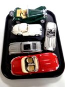 A tray containing a Danbury mint pewter E Type Jaguar with certificate together with four other