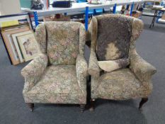 Two Edwardian wingback armchairs upholstered in a floral fabric (for reupholstery)