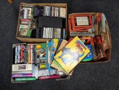 """Three boxes containing assorted DVD's, cassette tapes, 7"""" singles, books to include,"""