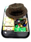 A tray of boxed vintage golf balls together with a gent's hat by Dunn and Company