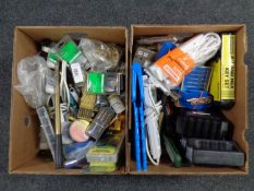 Two boxes containing tools, hardware, extension leads, battery charger,