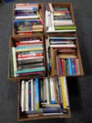 Five boxes containing a large quantity of hardback and paperback books to include cookery,