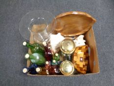A box containing assorted glass bottles, cafetieres, shells,