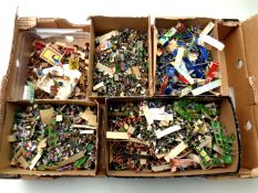 A box of a large quantity of miniature plastic soldiers and figures
