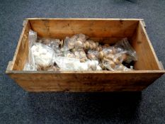 A vintage pine crate containing assorted wooden handles