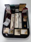 A tray of a quantity of costume jewellery to include marcasite earrings, pendants on chains,